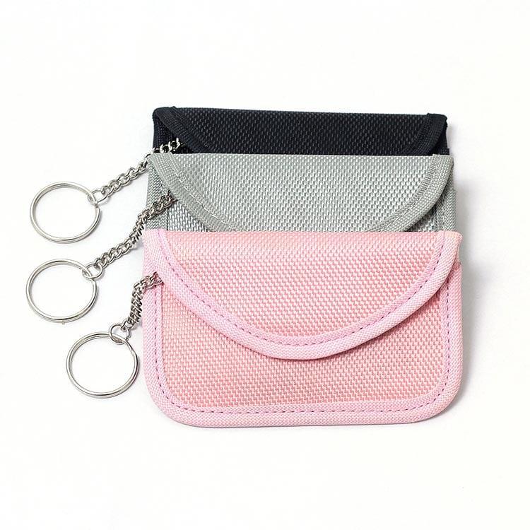 drei rfid/nfc Schutztaschen mit Oxford-Stoff in den Farben schwarz, grau und rosa