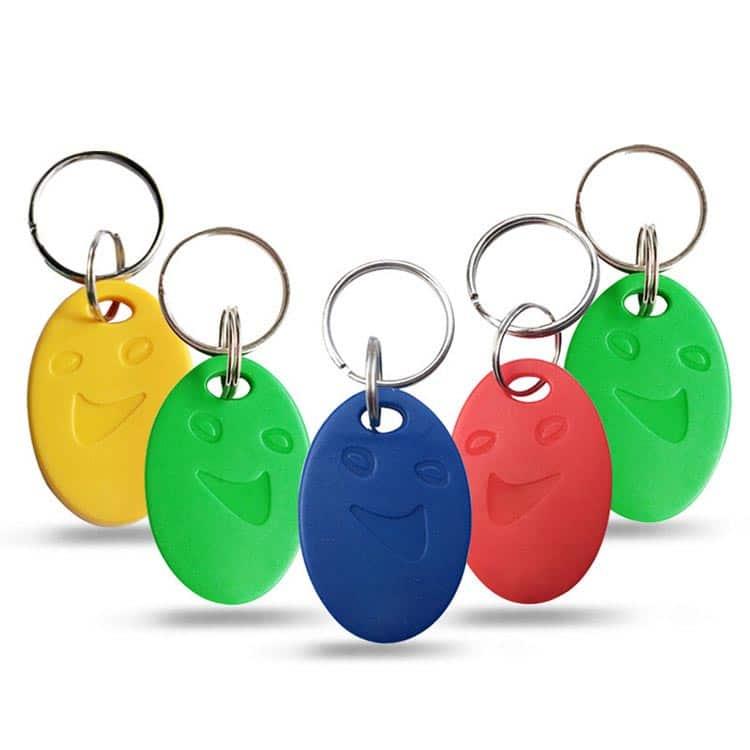 ABS RFID Schlüsselanhänger mit Smile in verschiedenen Farben wie gelb, grün, rot und blau