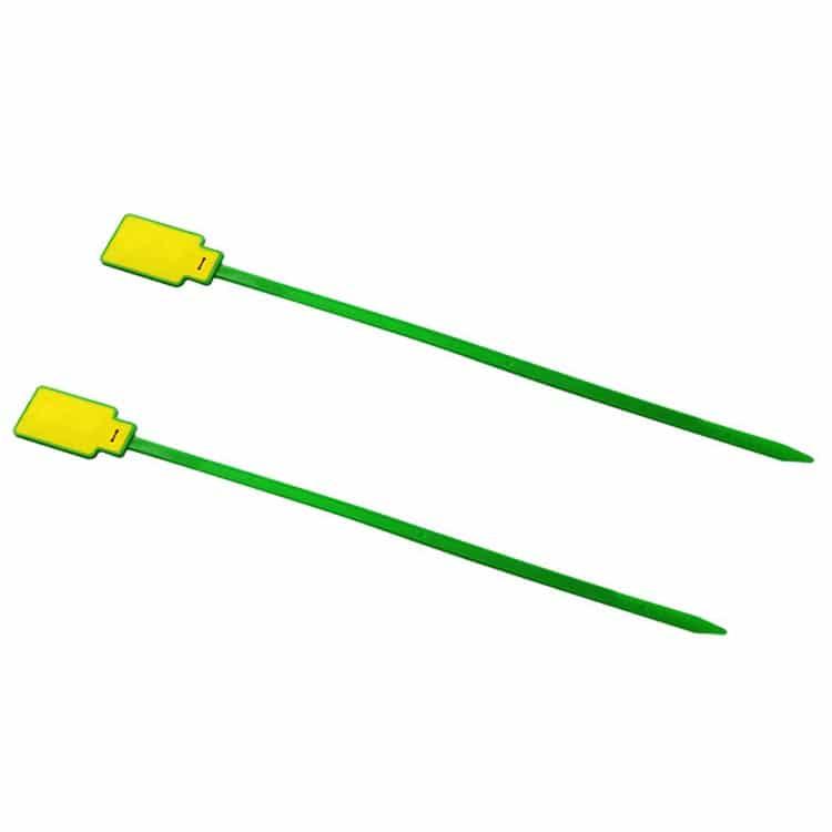 zwei grün/gelbe RFID-Kabelbinder am Boden